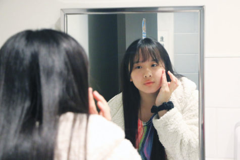 As part of her skincare routine, Senior Hannah Liu applies Blanc De La Mer cream, a facial hydrating mask used to moisturize and brighten the skin. Liu said skincare is an important part of her self care routine. Another thing that she chooses to incorporate in her life for self care is exercise, specifically dancing.