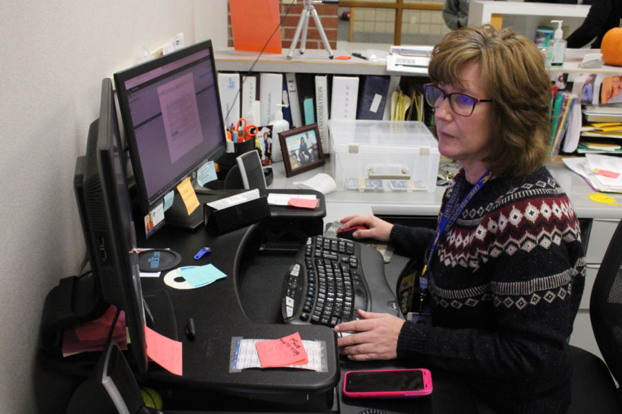 Activities Administration Assistant Karen Hayes checks and writes her emails. In the upcoming construction, she will be staying in the activities office. Hayes said Student Services will be in this office here eventually, so she'll have three people in there instead of two.