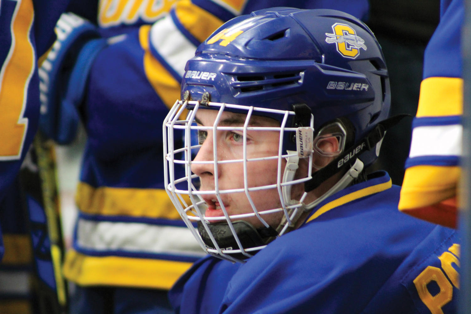 STAREDOWN: Nick Popowicks, a junior and forward on the Icehounds gold team, watches the game after finishing his shift during the Icehounds 5-2 victory over Zionsville. Popowicks said that although some Friday night games have student spectators, there are very few people that watch weekend games. I don't believe that not being associated with IHSAA has affected our performance, but it would be nice for hockey to be recognized as an IHSAA sport.