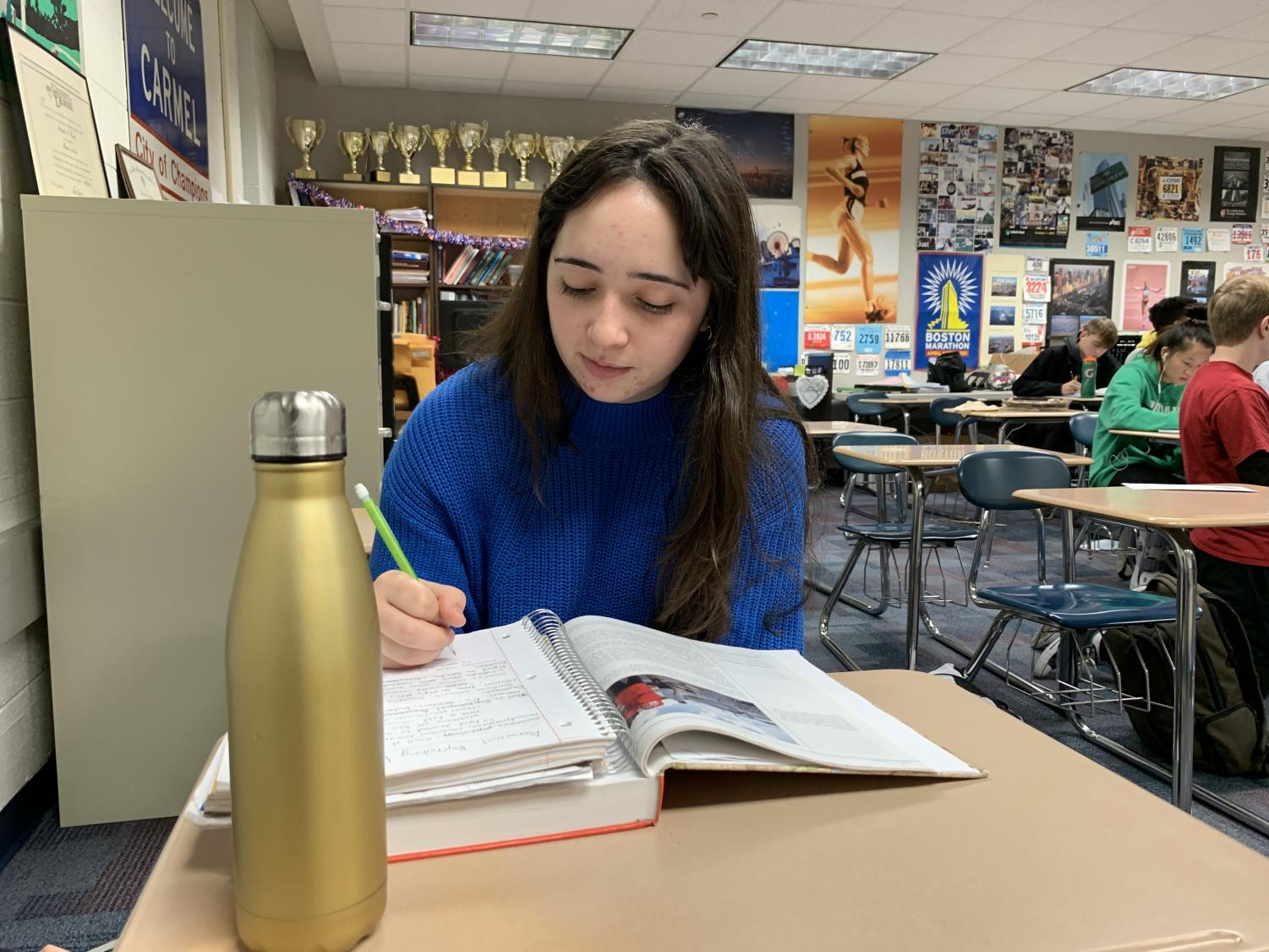 Nina Metaxas, CMYC vice president and senior, works on homework during SRT. According to Metaxas, CMYC is currently working on finalizing the details for its upcoming dodgeball tournament, which will take place Jan. 17.