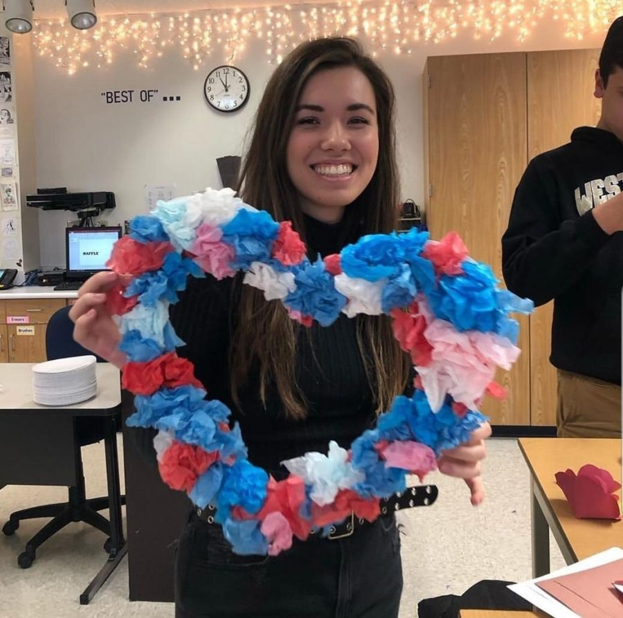 Kennedy Trypus, Carmel UNICEF officer and senior, showcases a piece of decoration for the Charity Ball. Club sponsor Jill Noel said the Charity Ball will take place on Feb. 14 from 7 to 10 p.m., and club members have been working on decorations and other preparations for the past few meetings.