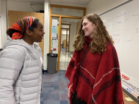Sarah Konrad, TEDx president and junior, (right) talks to Carmen Broadnax, TEDx club member and junior, (left) before the TEDx meeting on Jan. 27. Konrad said the club's main focus right now is planning for the speaker auditions, which are scheduled for Jan. 30 in Room E235.