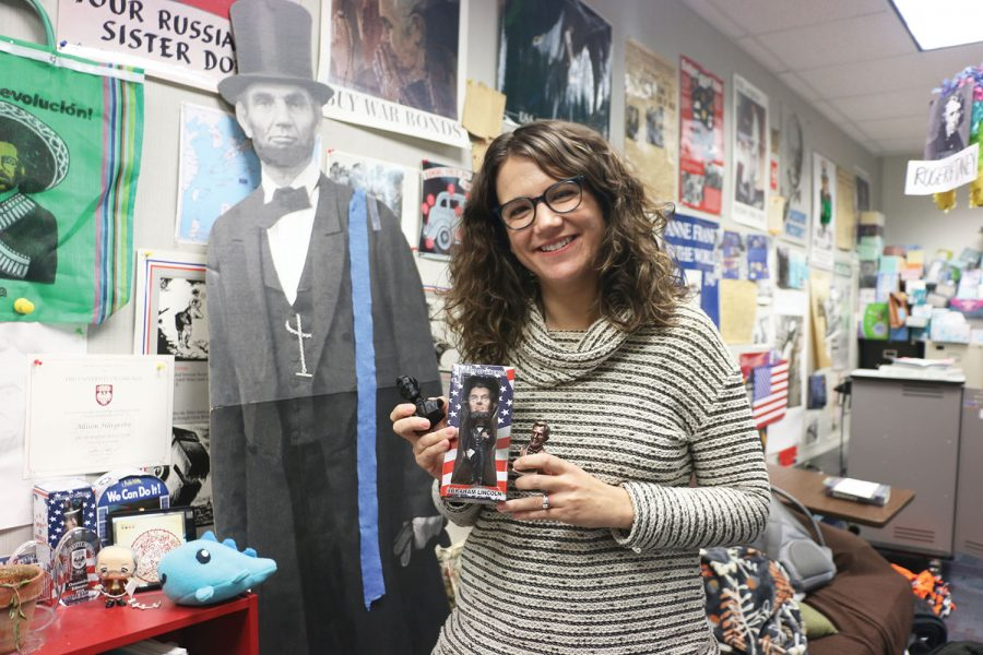 History+teacher+Allison+Hargrove+displays+her+figurines+and+cutout+of+Abraham+Lincoln.+Hargrove+said+she+looks+up+to+Lincoln%E2%80%99s+bravery+and+passion.