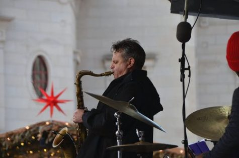 "A saxophone player from Monika Herzig Acoustic Project plays ""7 Rings"" by Ariana Grande at the main stage at the Carmel Christkindlmarkt on Dec. 20, 2019. Monika Herzig Acoustic Project played from 4 to 6:45 p.m."