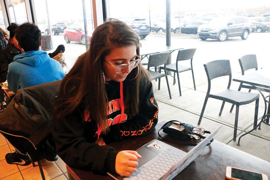 Junior Piper Conway views Juice WRLD's music and videos on her laptop. She said his death influenced her greatly because she has looked up to him and saw him as an inspiration. Juice WRLD was 20 years old when he passed away on Dec. 8, 2019 in Oak Lawn, Ill.