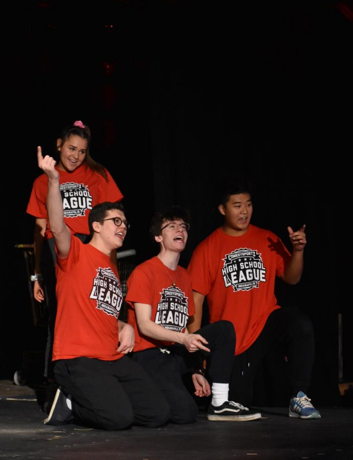 Maddie Blank, Jack Ducat, Austin Audia and Ian Wang (left to right), Comedy Sportz members  and juniors, compete in their first SRT match on Feb. 11. The red team was victorious in this match and will compete again today during SRT in the studio teacher.