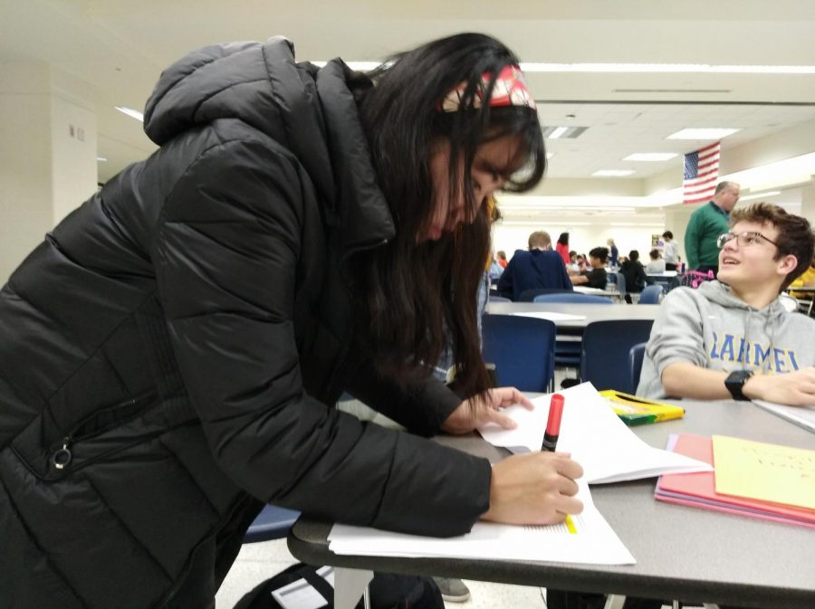 Senior Jaehee Kim signs into a DECA meeting during SRT. The state competition will take place March 1 to 3 in Indianapolis.