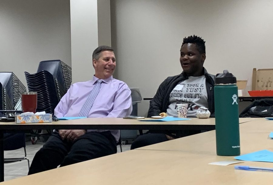 Principal Tom Harmas discusses Culture of Care week activities with Speak of the house Deion Ziwawo. Culture of Care week with take place during next week.