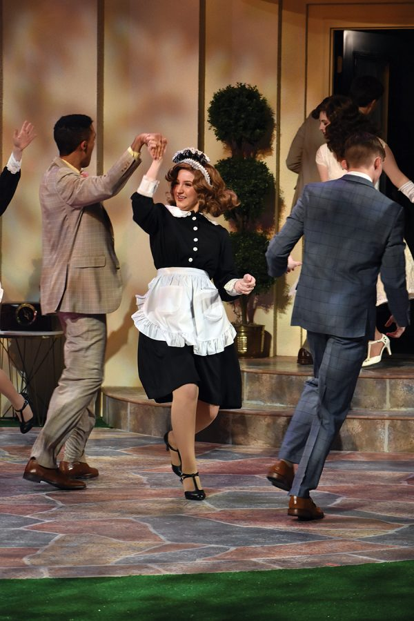 """Julia Ammons (center), actress in the Civic Theatre's """"Much Ado About Nothing"""" and senior, dances with actor Jonathan Doram during a dress rehearsal on Feb. 6. The dance takes place in celebration of the wedding between Claudio and Hero during the ending of the play."""