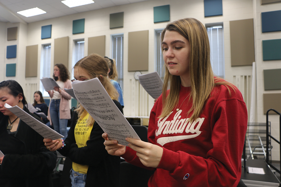 WORK HARD, SING HARD: Emme Walschlager, Allegro member and senior, sings during her choir class. Walschlager said competing allowed the choir to work harder towards a higher goal.
