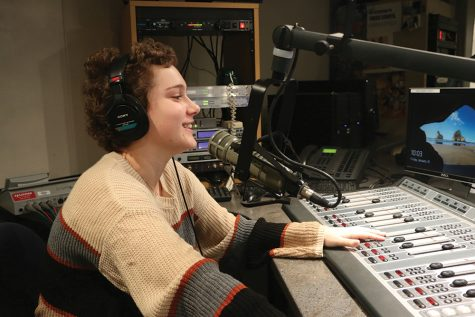 Jesse Cooper, WHJE staff member and junior, practices broadcasting for the Riley-a-Thon on WHJE radio. Cooper said she hopes the Riley-a-Thon will continue as an annual event even after her graduation.