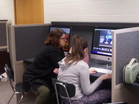 CHTV supervisor Brandy Ostojic assists Katherine Sehgal, CHTV staff member and senior, with editing.