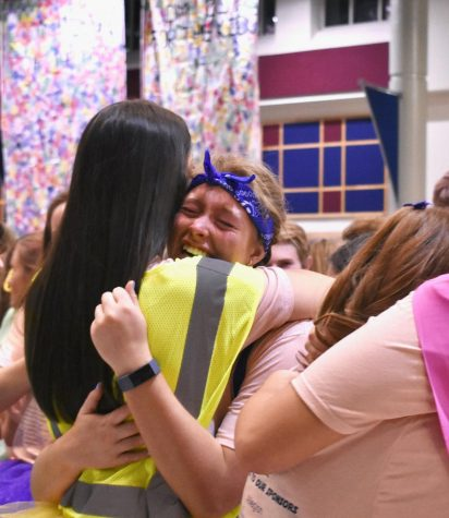 Elizabeth Hildebrand, Cabinet member and junior, celebrates by hugging a fellow Cabinet member at the end of Dance Marathon on Feb. 29. CHS students who participated this year fundraised the largest total in Carmel Dance Marathon history. The final total came out to $473,394.15 raised for Riley Children's Hospital.