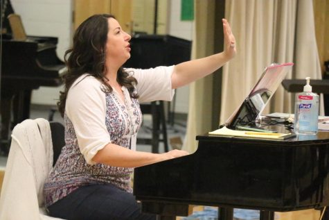 Accents director Katie Kouns plays piano during evening rehearsal on February 6th. The Accents' competition season was cut short due to COVID-19 cancellations.