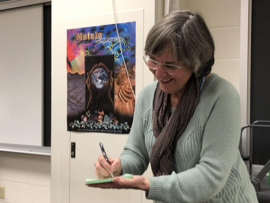 Chemistry Club sponsor Virginia Kundrat writes an SRT pass for one of her AP Chemistry students on March 10.