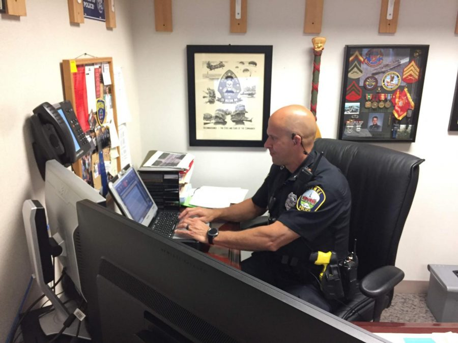 School Resource Officer Shane VanNatter views information on his computer. VanNatter said the additional SRO will help them mentor students and provide guidance in challenging situations.