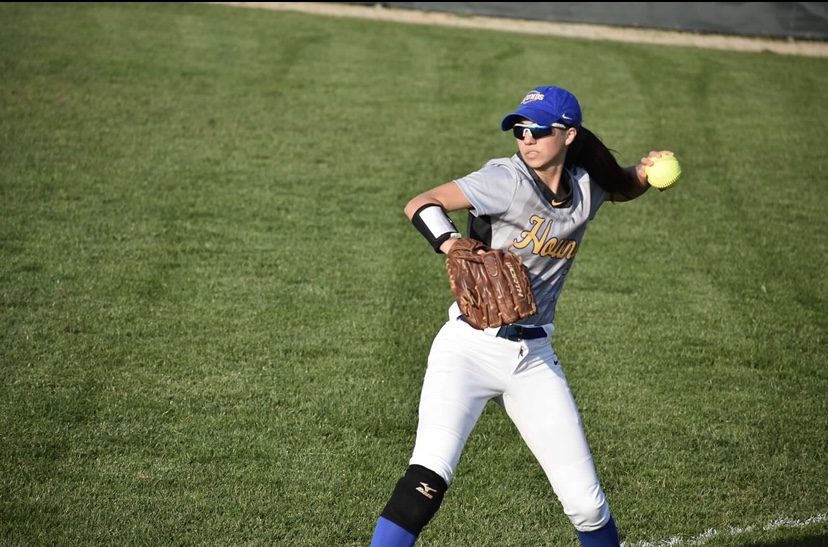 Ella Ohrvall, softball player and sophomore, practices pitching. Ohrvall said the softball team can no longer hold group practices due to the break from school.