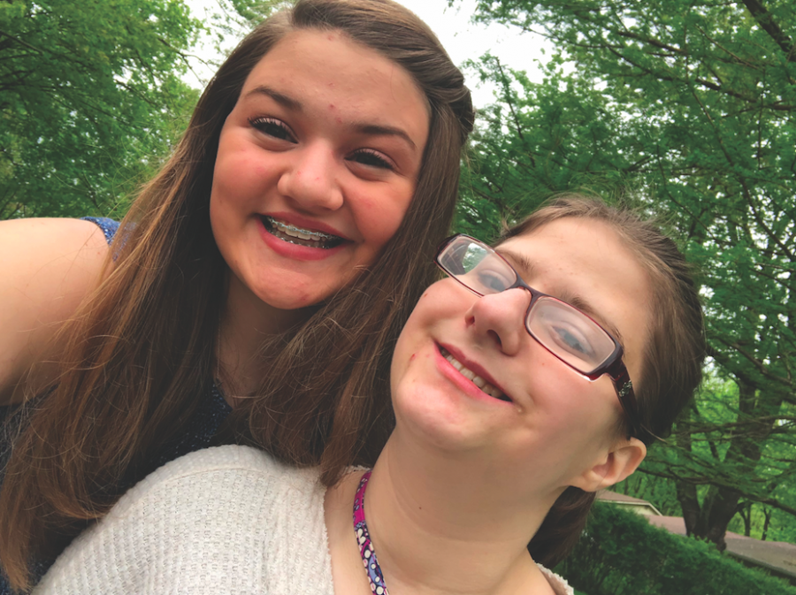 SISTER+SELFIE%3A%0AEmily+Sandy+%28LEFT%29%2C+staff+member+and+sophomore%2C+and+senior+Claire+Sandy+%28RIGHT%29+pose+for+a+selfie.+Emily+said+they+love+to+look+at+filters+on+Snapchat+and+watch+cat+videos+together.+