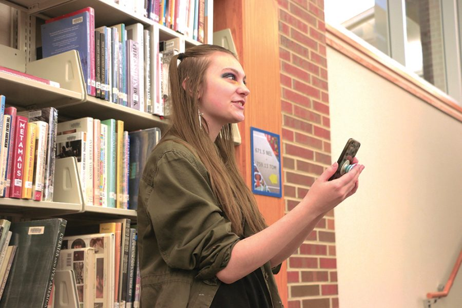 "Junior Alli Johnson recites ""Fire and Ice"", a poem by Robert Frost, during late start on March 4. Johnson said poetry is for everybody and isn't something to be afraid of, as the subject of the poem can be whatever the poet would like it to be."