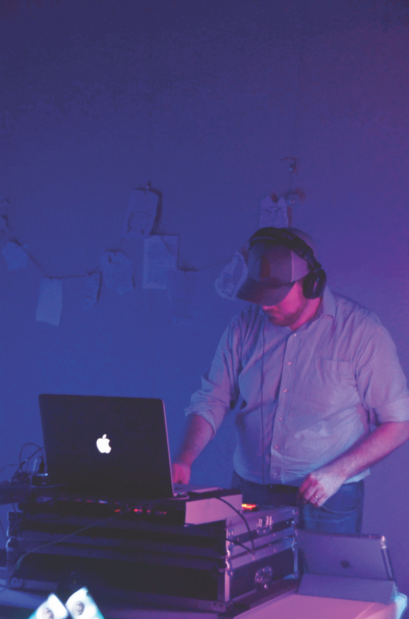 Chad Andrews, DJ and English teacher, mixes music for the Yule Ball at the Carmel Clay Public Library. The event, inspired by the dance of the same name in Harry Potter and the Goblet of Fire, was filled with food, music and dancing.