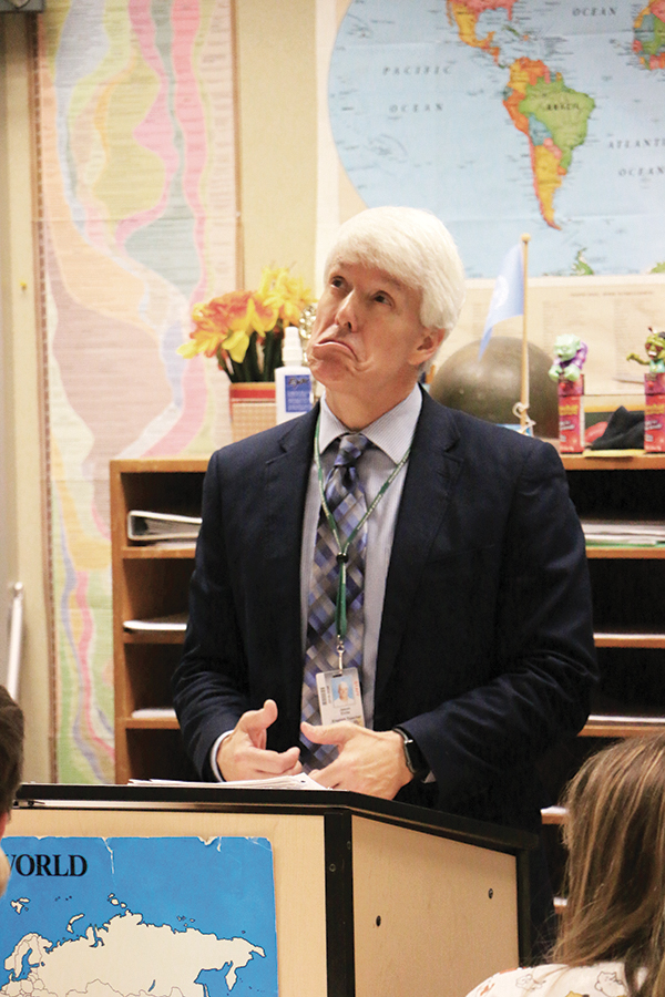 """English teacher Jason ElRite reads """"reverse poems"""" written by students in the Honors English 9/AP World History block class. ElRite said reading these poems out loud and anonymously can give validation to students who do not interact with their peers."""