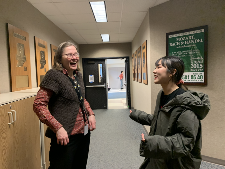 Carmel Electric Ensemble president and senior Jiwon Yu and club sponsor Elisabeth Ohly-Davis discuss the types of music the ensemble will be playing at their upcoming rehearsal in late March or early April. Yu said that the ensemble will be playing more pop and rock songs at their spring concert.
