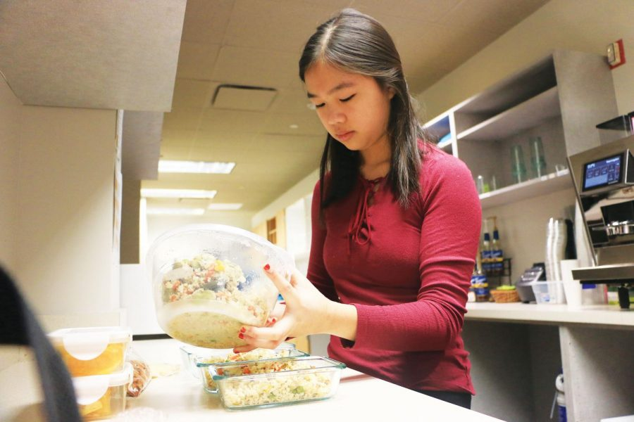 Junior Melissa Su divides her lunch into individual boxes to make it easier to bring in the morning. Su said she started focusing on having a more balanced diet last month.