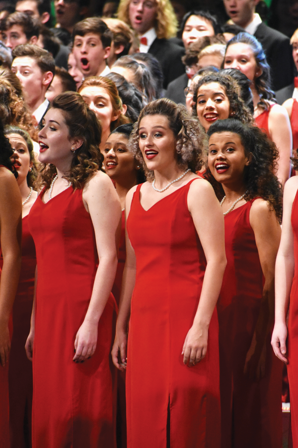 LEAVING MY MARK: Sofi Rivera, Ambassadors member and senior, sings during Holiday Spectacular. Rivera said the Legacy Concert inspires her to leave her mark on the choir program.