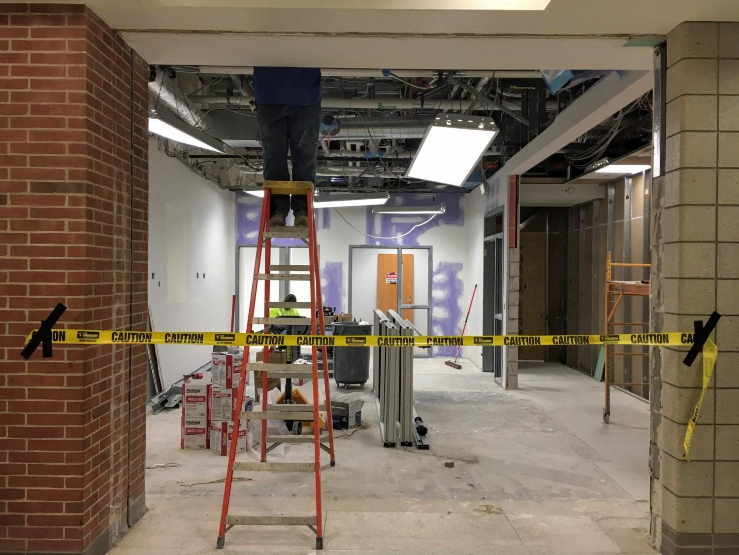 Construction workers carry out their jobs prior to CHS moving to online schooling. Despite COVID-19 construction continues to happen at CHS though there have been changes made to the timeline.