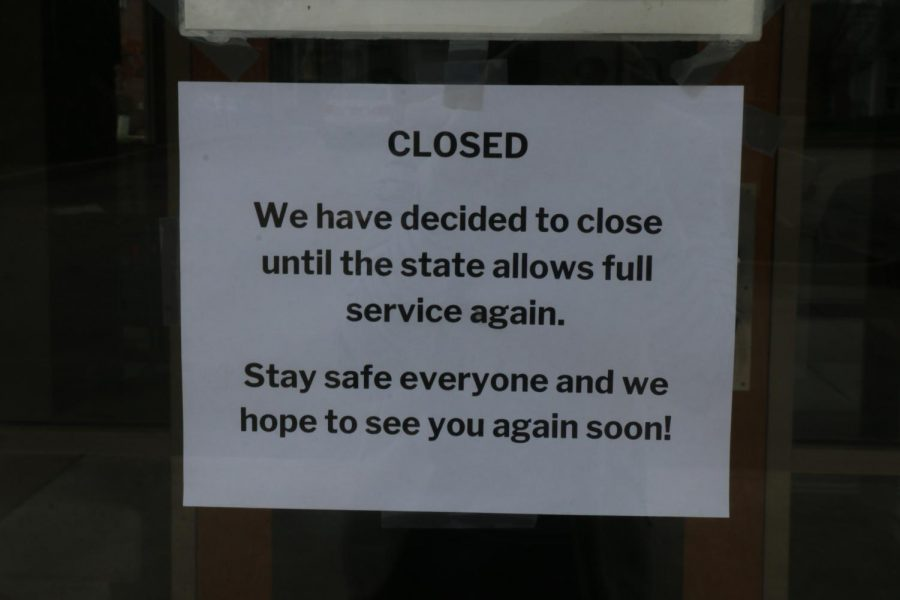 A sign on Wild Ginger on 116th's door announces the restaurant's temporary closure. On March 16, Indiana Governor Eric Holcomb announced that all restaurants were to close their dine-in services.