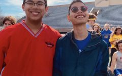 Eshan Selvan, Unified track athlete and senior, poses with teammate and senior Mike Herod during a meet last season. Eshan said although there are no unified sports in college he would continue to participate in Special Olympics events.
