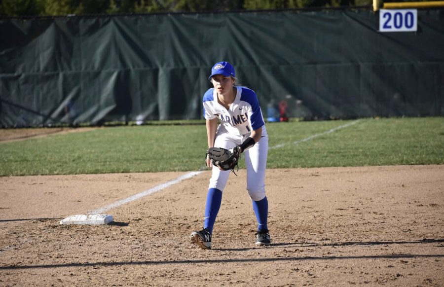 Sarah Goddard, softball player and senior, waits to catch during a game last season. Goddard said it was heartbreaking to know she would never wear the Carmel jersey again.