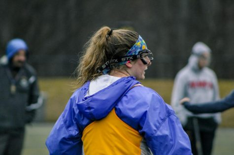 """CHS varsity women's lacrosse member and sophomore Sophia """"Sophie"""" Hanna looks to a teammate after completing a drill in practice on Monday Feb. 24. The team will compete in their first home game of the season on March 24 at Murray Stadium."""