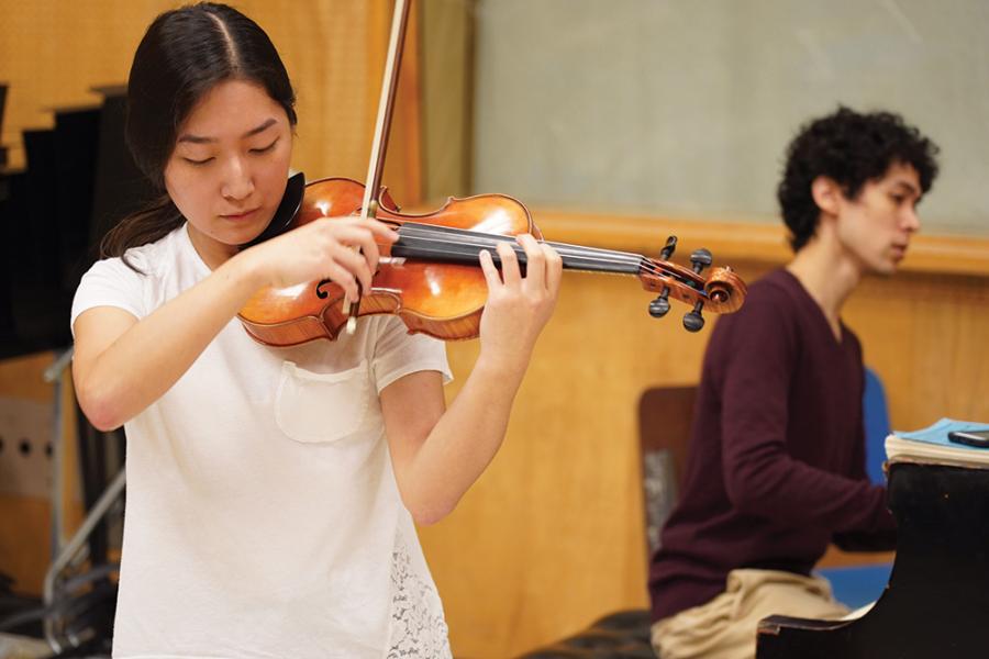 A WHOLE NEW EXPERIENCE: Sophomore Abigail Ko practices at the IU Jacobs School of Music as a part of the pre-college String Academy program. Ko said there is nothing like the program in Indiana and it's the best she has experienced.