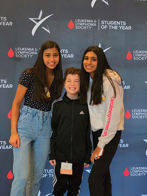 Janvi Bhatia, Carmel HOSA activities co-chair and junior, poses with her sister, sophomore Rhea Bhatia, and Ty Talatin at a Leukemia and Lymphoma Society event. This was pre-lockdown.