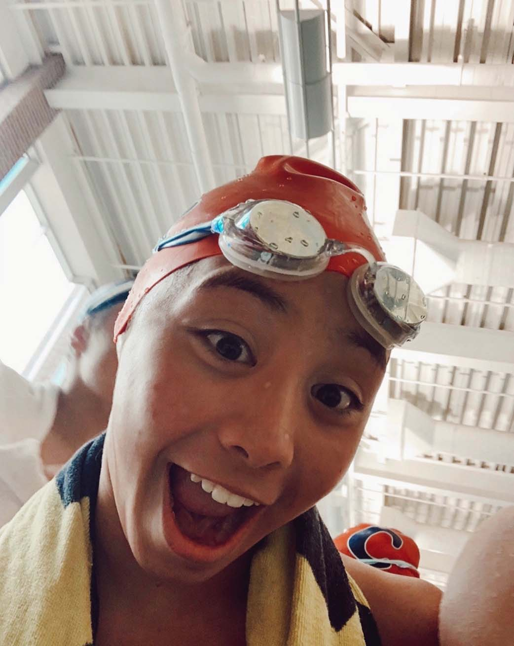 Swimmer and sophomore Analiese DeLeon posses in her swimming gear. Her team continues to exercise through Zoom.