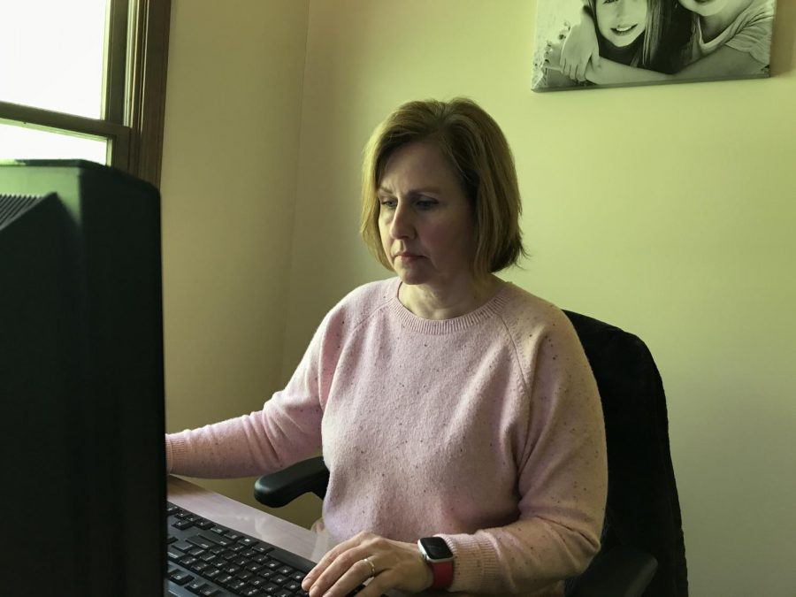 """Melanie Chmielewski, mother of junior Ally Horwitz, works from her computer at home on Monday. She, like many others, has a job that allows for remote work during COVID-19. """"I work from home nearly every day, so I am very fortunate to have a job with such flexibility."""""""