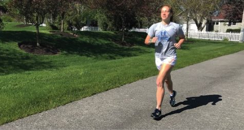 SOLO JOG: Junior Yael Kiser runs on her own on May 2, the original scheduled date for the Indy Mini Marathon. Kiser was originally registered to run the Mini Marathon but chose to transfer her registration to next year. She said she preferred the environment of the in-person race.