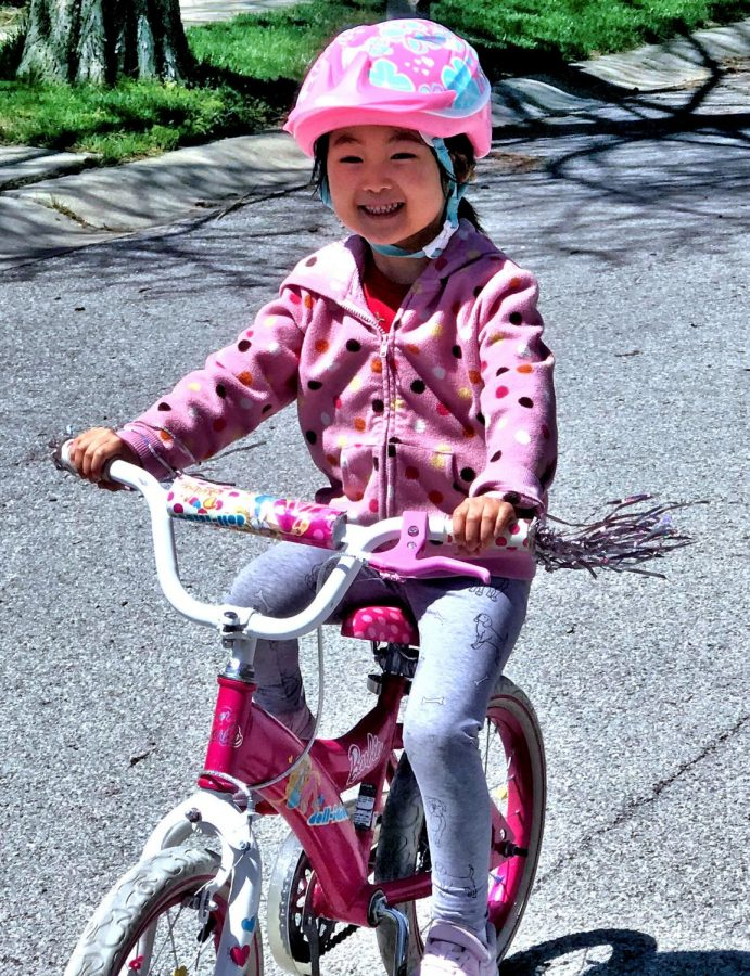 Five-year-old Marissa Wan experiences her first time on a bicycle during our family's outdoor walks on May 6, 2020, in our neighborhood Overlook Hazel Dell. Marissa persevered and achieved her goal to ride a bicycle in a week.