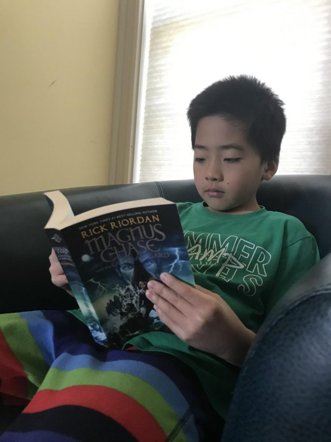 My brother, Luke Zhang, reads the book his teacher assigns him as a part of his E-learning work during his day off on May 8, 2020 at his house. Luke read many books during the E-learning period and finished around 8 books.