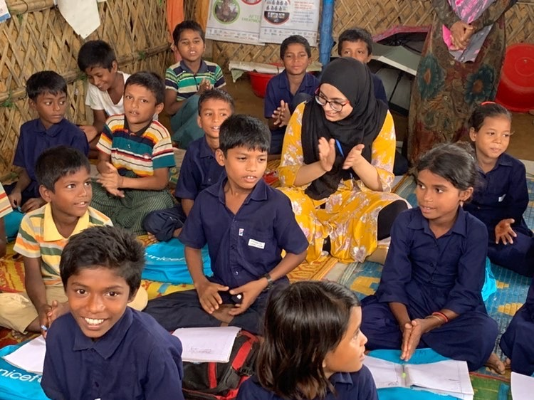 Sophomore Maleeha Mahbub interacts with Rohingya student refugees at a refugee camp in Bangladesh. She spent a few days there during the summer of 2020 and helped Rohingya refugees who fled Myanmar to escape targeted violence and human rights violations.
