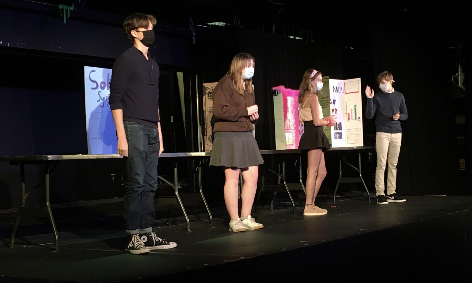 Jack Sullivan, Reagan Nagel, Ella Owens and Theo Curtis rehearse for the Studio One Acts for this upcoming week. They star in the play called Regina Flector Wins the Science Fair directed by senior Muriel Mota Schaffer. Nagel plays Regina, Sullivan plays Bradley, Owens plays Tiffany and Curtis plays Sam.