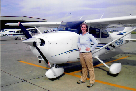 Social studies teacher Katie Kelly poses in front of a plane after passing her Private Pilot License Exam and FAA check ride on October 31, 2008. She completed the tests at Mt. Comfort Airport (now Indianapolis Regional Airport).