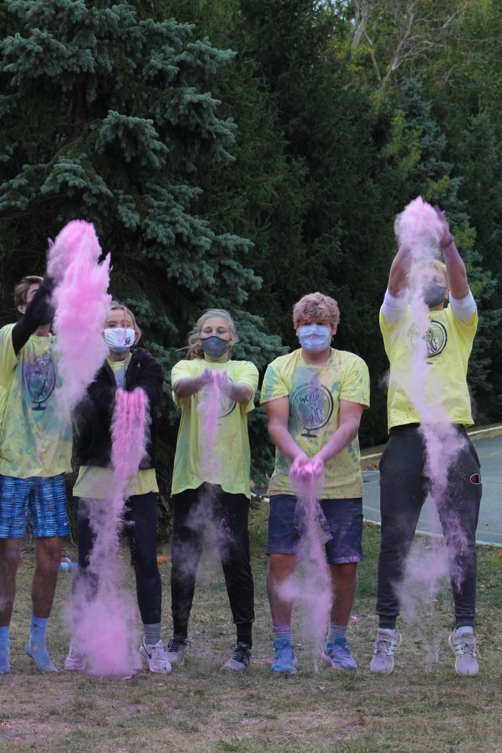 From left to right, senior Max Mylott, senior Ella Hebert, sophomore Allie Wolf, senior Jacob Young and junior Zach Osborne throw colored paint powder in celebration of the end of the FT3K Color Run Race on Oct. 3. The Cabinet organized the event in order to raise money for Riley Children's Hospital.