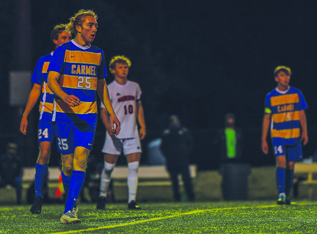 MENTALLY SHARP: Junior Baenan McKeown gets ready to kick a soccer ball during a home soccer game against Guerin Catholic High School. Mckeown said that it is important to be motivated during physical therapy, and said he was mentally sharp with his injury.