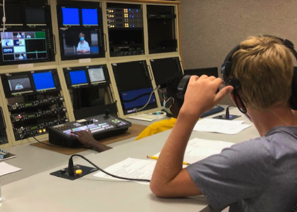 CHTV staff members work behind the camera to assure audio and video quality. When recording, the staff makes sure to take breaks every ten minutes to assure social distancing guidelines are followed.