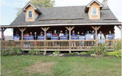 Volunteers for Indiana senator Victoria Swartz's congressional campaign pose with campaign signs at Spartz's campaign headquarters.