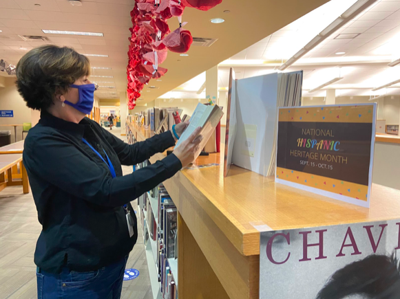 The media center staff works to put out new books and displays for the students of the high school frequently. Because Hispanic Heritage  Month is underway, the staff put out a display with books on the topic.