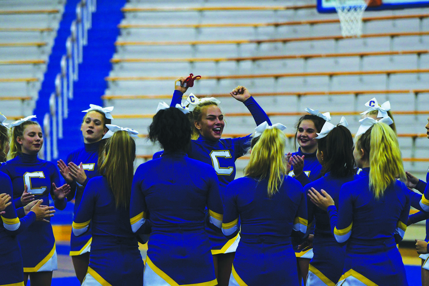 CHEER-ING UP: Riley Shockey, varsity cheerleader and senior, pumps up her team for an upcoming routine. Shockey said when she performs in front of an audience there is more excitement and adrenaline.However, with new COVID-19 safety guidelines, her virtual performances have no audiences, which she said makes it harder to perform.