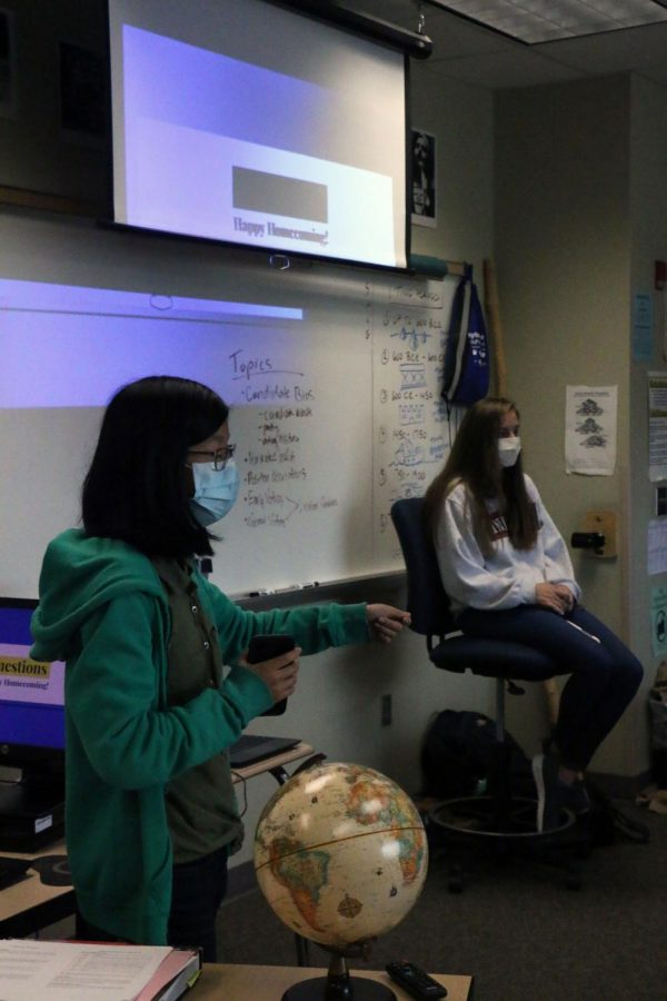 Jenna Carter, right, Civics Club co-president and senior, wraps up the Oct. 2 meeting by answering a club member's question. According to Carter, participation is important to democracy.